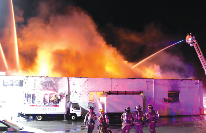 Building, Cars Burn in Mineola