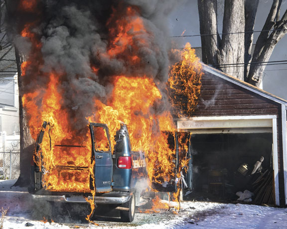 Van Fire Stopped Before Garage Goes