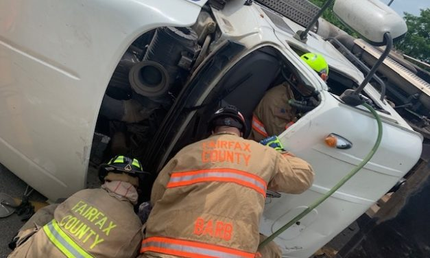 FIREFIGHTERS EXTRICATE TRAPPED DRIVER FROM DUMP TRUCK ROLLOVER
