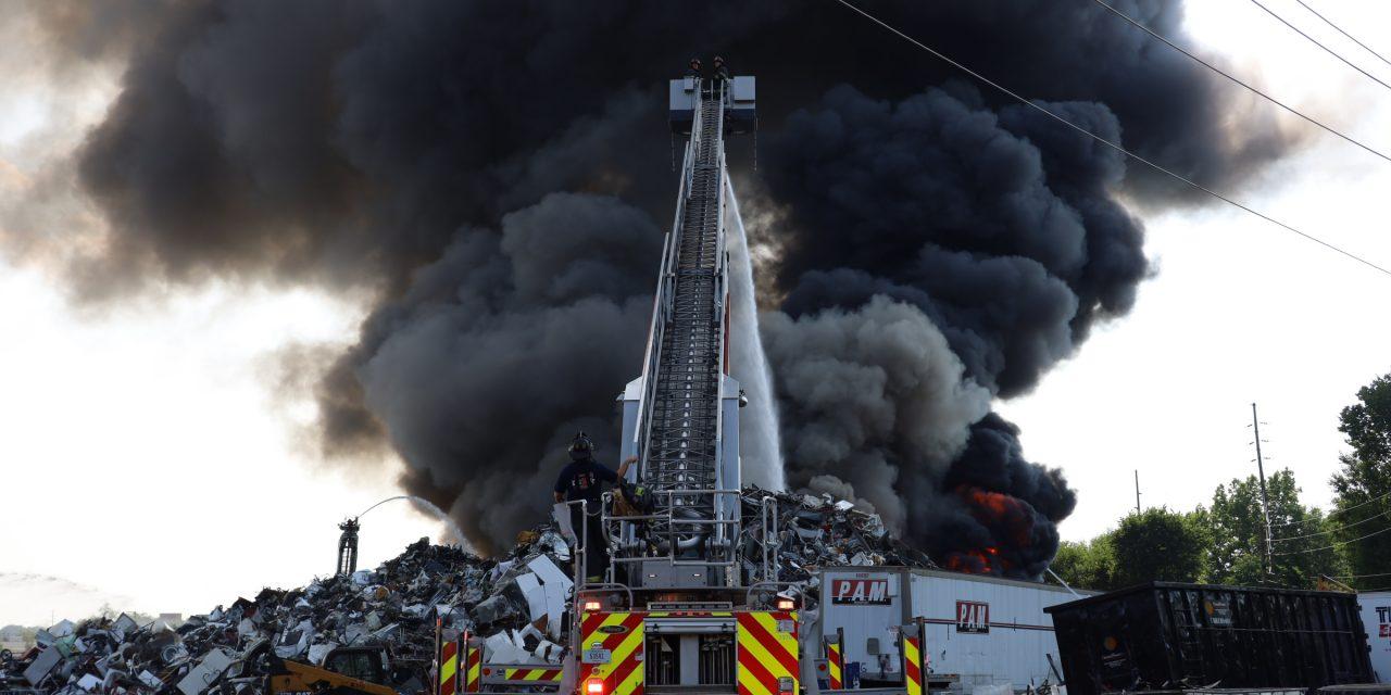 INDIANAPOLIS FIREFIGHTERS BATTLE MASSIVE SCRAP YARD BLAZE