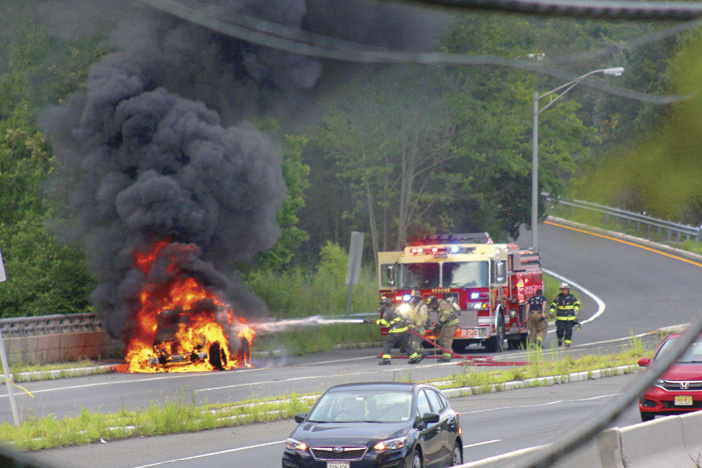 Fire Engulfs SUV in Lawrence Township